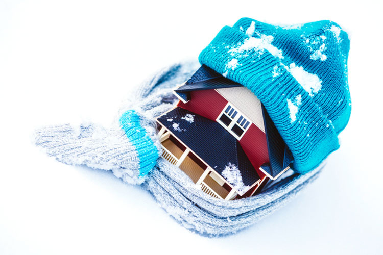 House Wrapped in Scarf | Home Winterization Tips