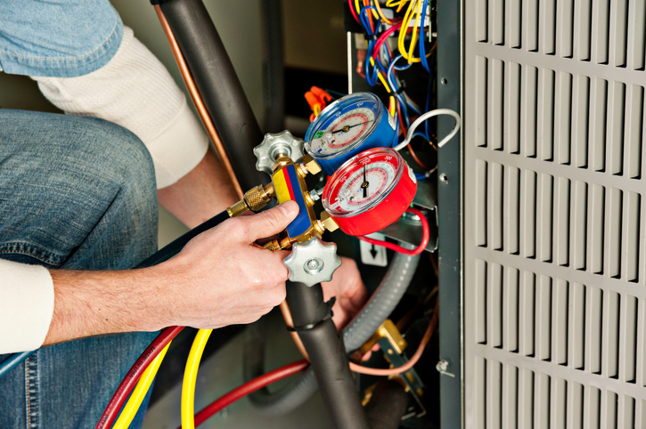 HVAC Technician Testing Furnace | Tyler Heating, Air Conditioning, Refrigeration LLC